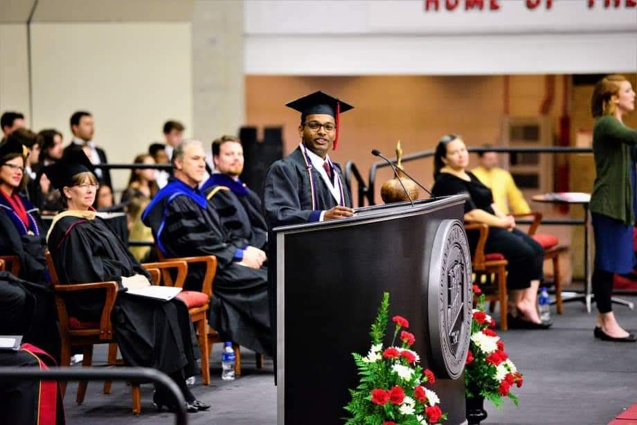 Yuganesh, from Malaysia, speaks at the UCM graduation ceremony.