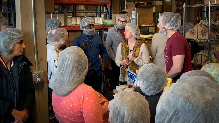 An ELI student asks a question during the factory tour