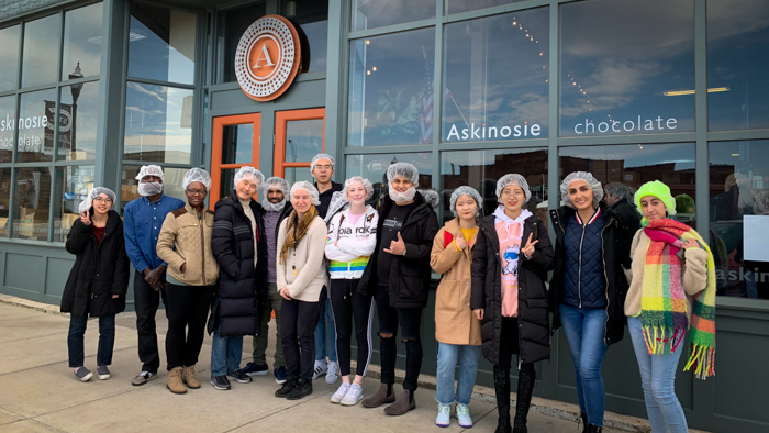 Students pose in front of the Askinosie Chocolate factory.
