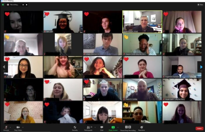 Screenshot of zoom meeting with heart reactions from participants