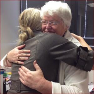 Peggy Gilbert hugging a student