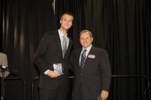 Photo of Matt George with award