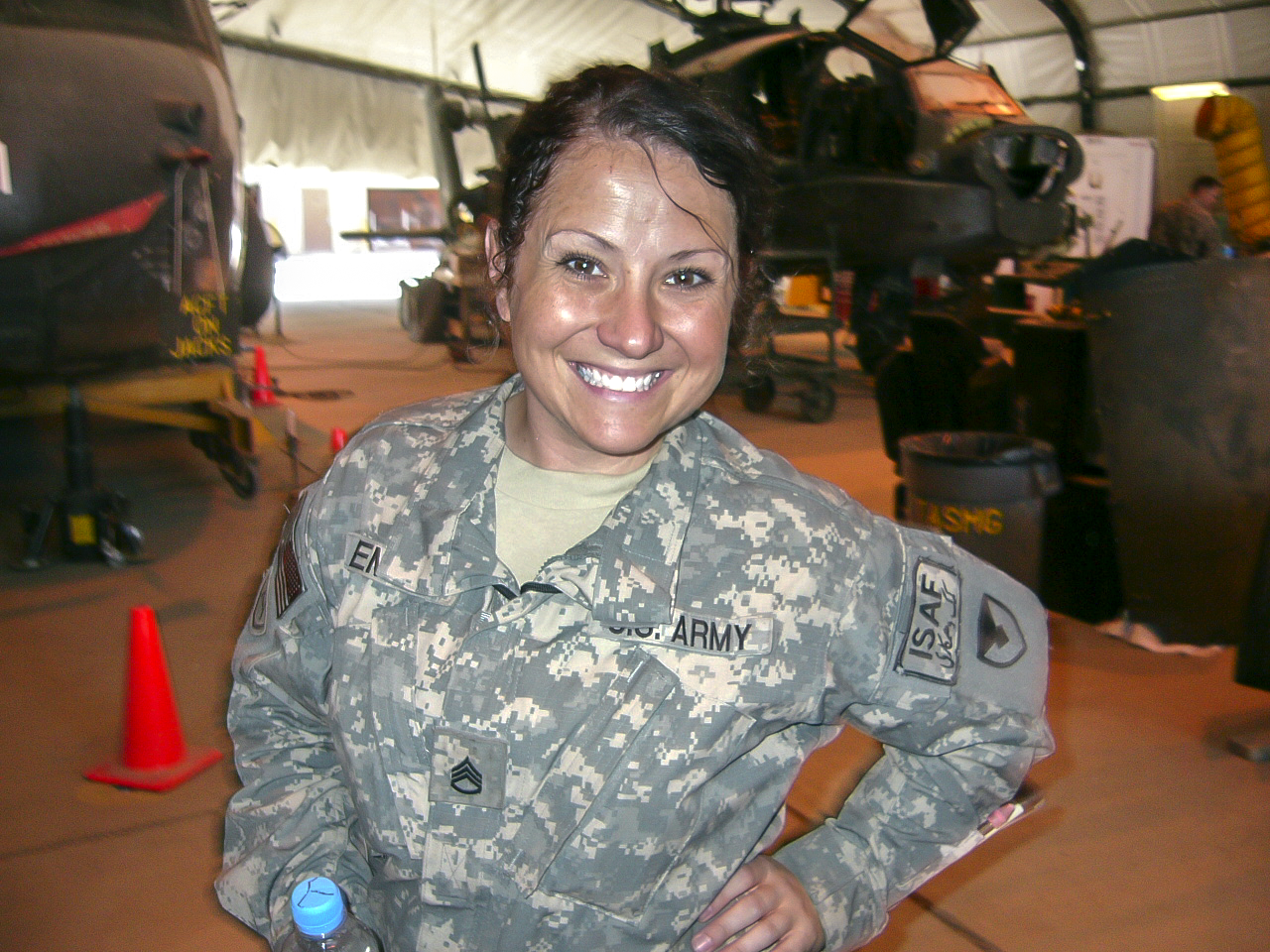 Photo of Tracey Emily in uniform in font of a helicopter