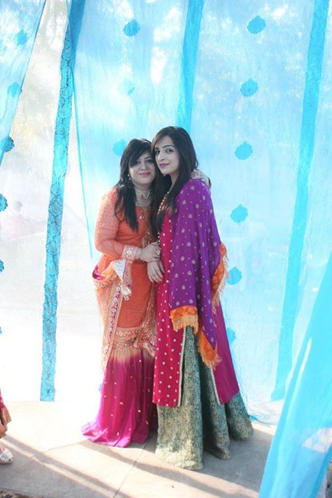 Maryam with a friend in formal dresses
