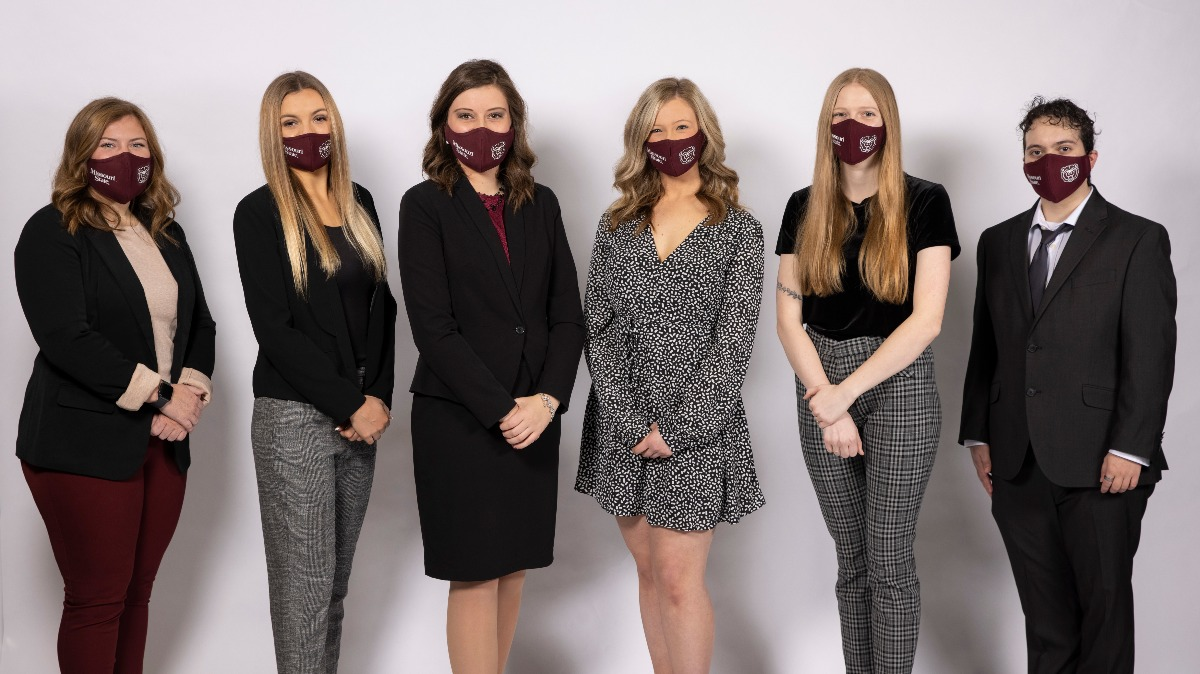 Cayley with fellow The 2020-21 Citizen Scholars Award recipients. All are masked.