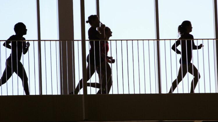 silhouettes of women running