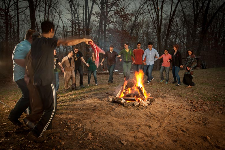 Students around a bonfire