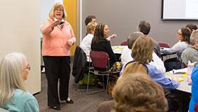 Dr. Berquist talking to a class