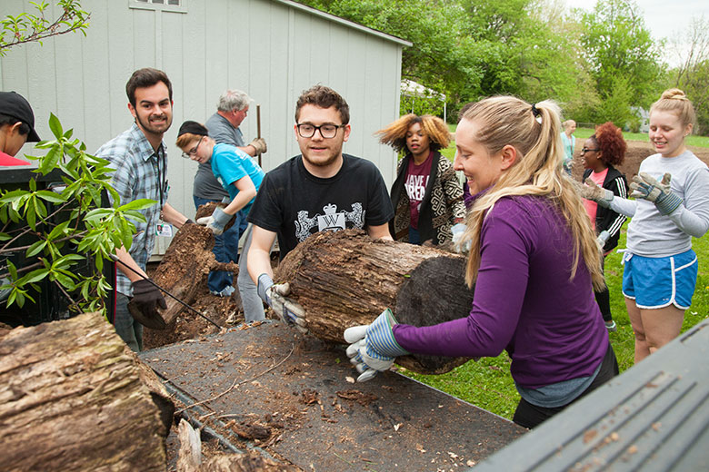 Students cleaning up yard waste