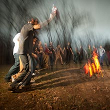 Students celebrating around a bonfire