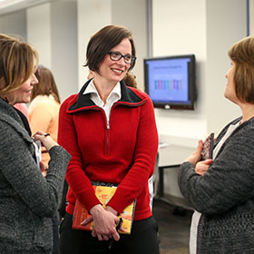 Keri Franklin conversing with colleagues