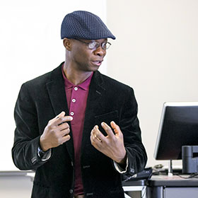 Dr. Oyeniyi teaching in classroom