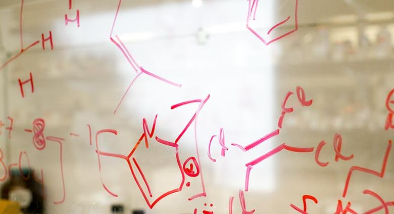 Chemistry formula written on a glass marker board