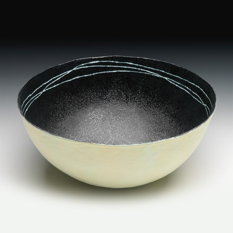 Bowl with black inside and striped accent