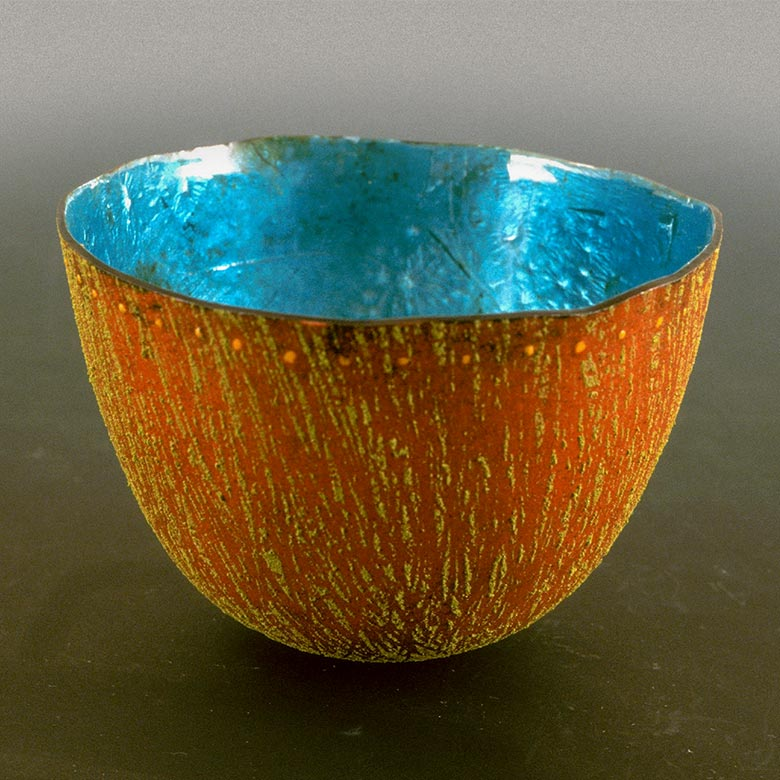 Orange textured bowl with blue interior