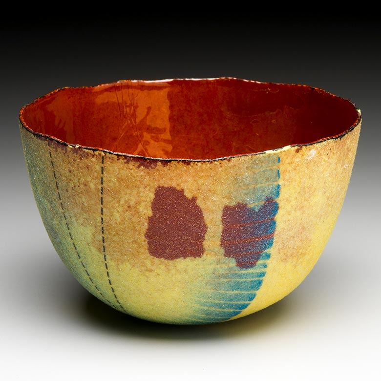 Yellow bowl with two red marks