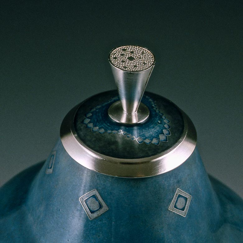 Detail of blue container with multi pointed bottom and diamond pattern