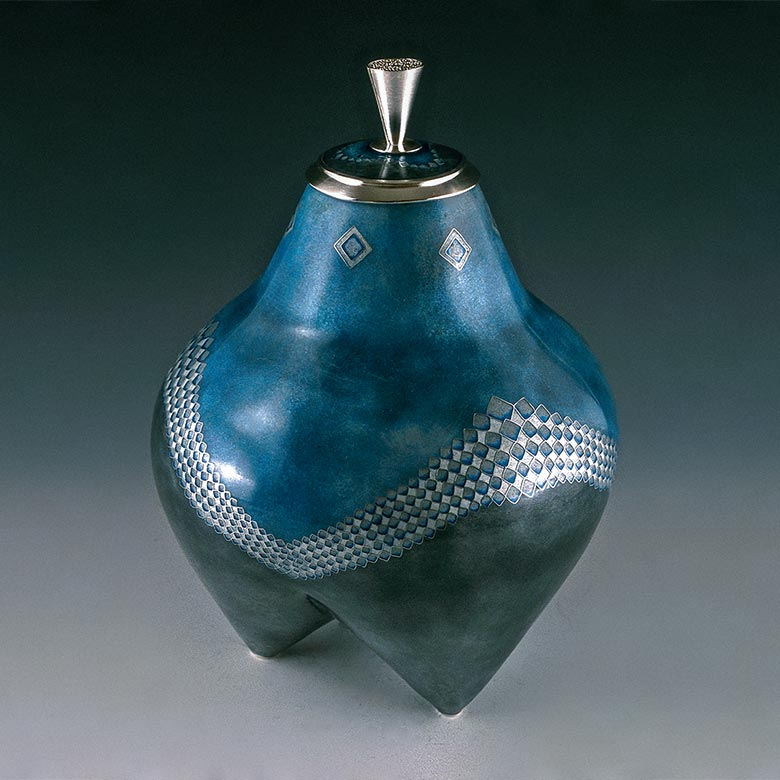 Blue container with multi pointed bottom and diamond pattern