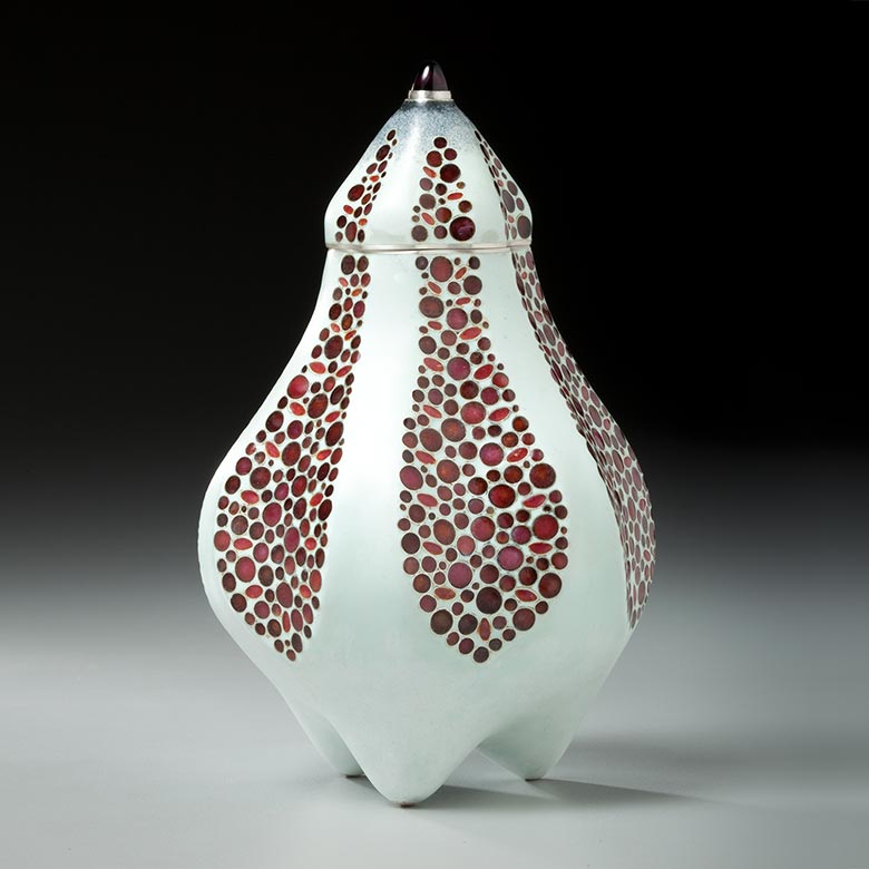 White container with multi-pointed bottom and red circular accents
