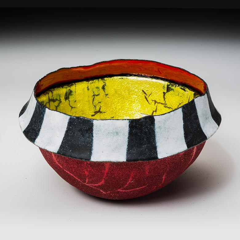 Red bowl incorporating Delhi striped pattern