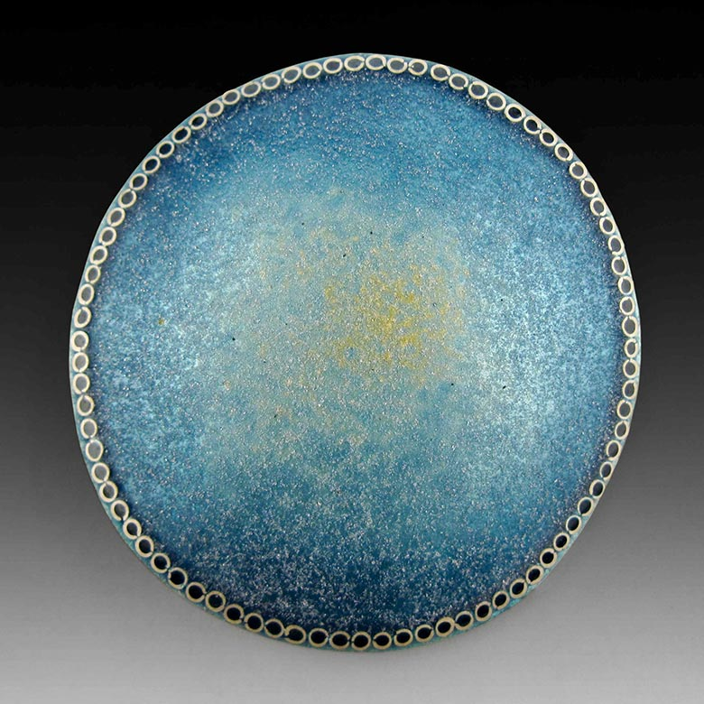 Circular brooch with field transitioning from blue to ochre