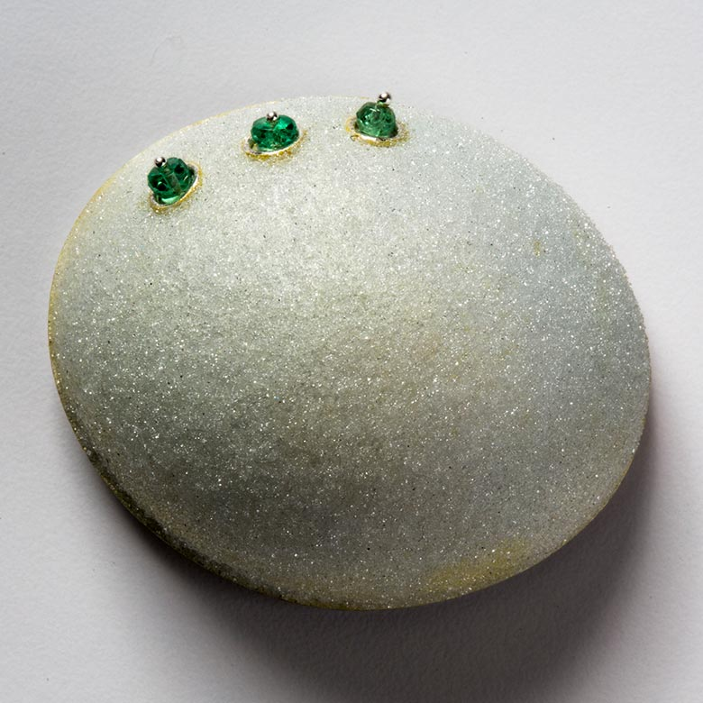 Snowball-inspired brooch with three green accents