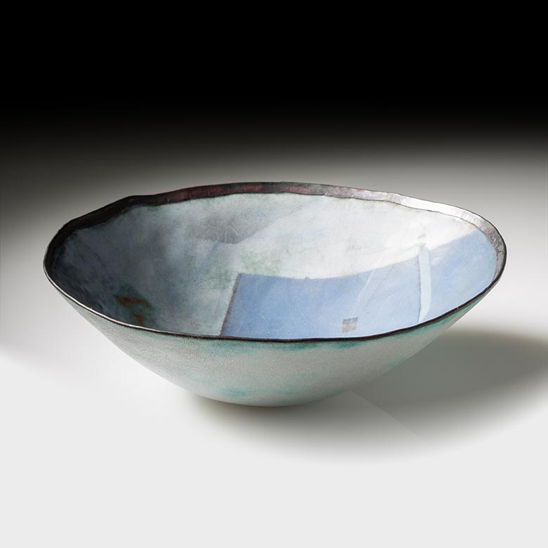 Front view of bowl with blue building design