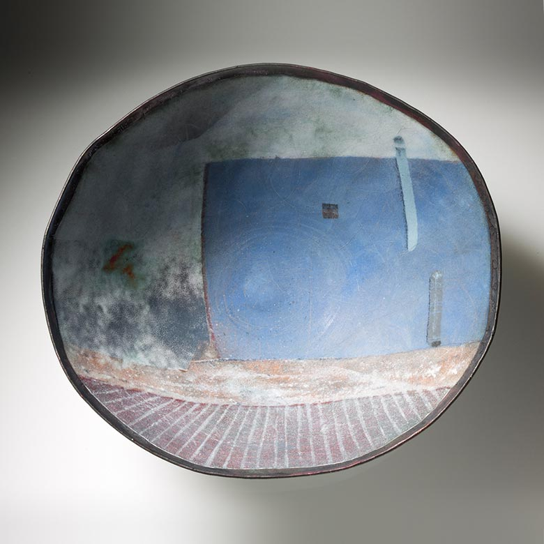 Top view of bowl with blue building design