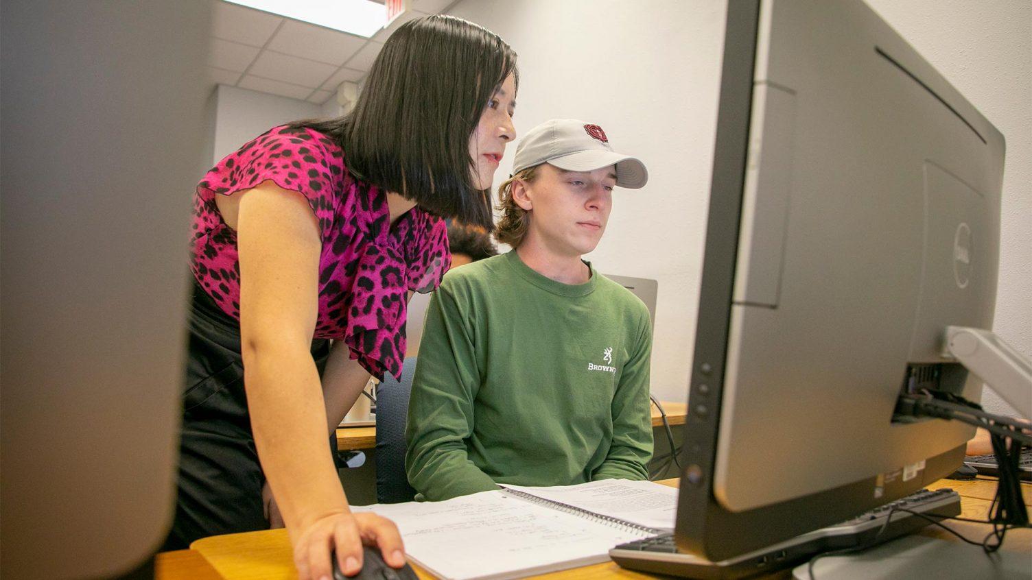 Dr. Liu helping a student