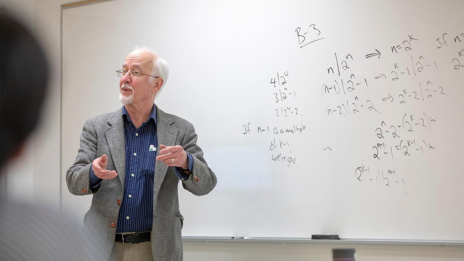 Dr. Les Reid explains an equation to a class
