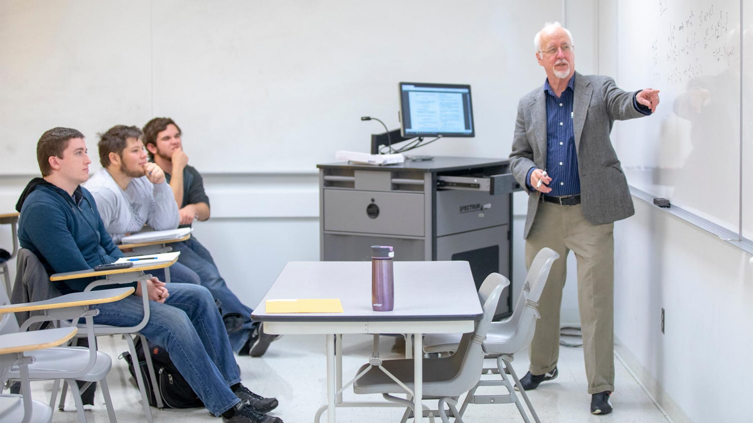 Dr. Les Reid explains a concept to a classroom of students