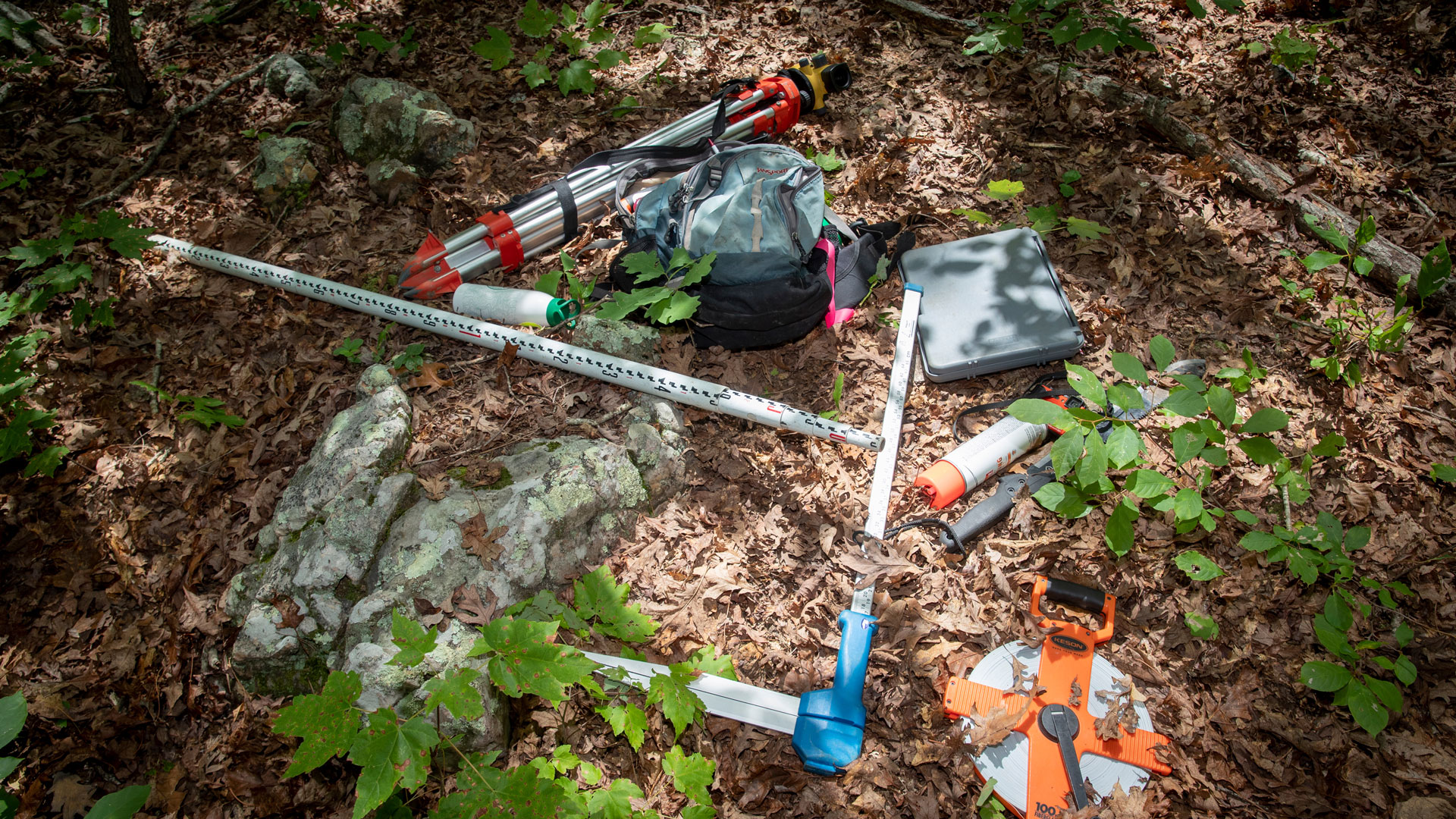 Surveying and assessment equipment lays on the ground in the Mark Twain National Forest on July 17, 2018.