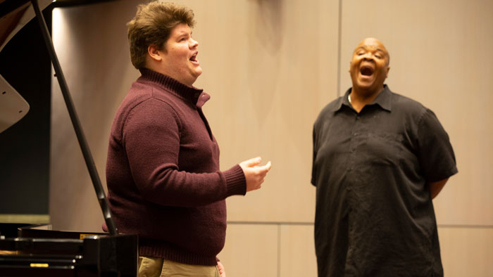 Student Alex Smith and Dr. Todd Payne perform a duet in class.
