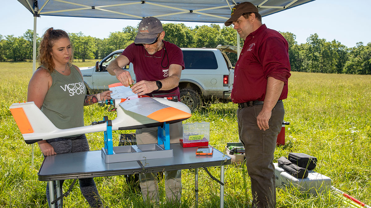 Bailey Wolf with Drs. Toby Dogwiler and Michael Goerndt prepare drone