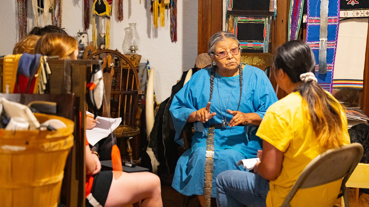 Vanessa Jennings speaks with group of students in her home.