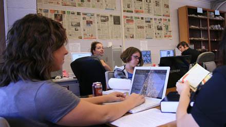 Journalism students working