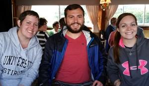 Brett surrounded by friends on boat to Loch Lomond.