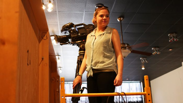 Student operating camera