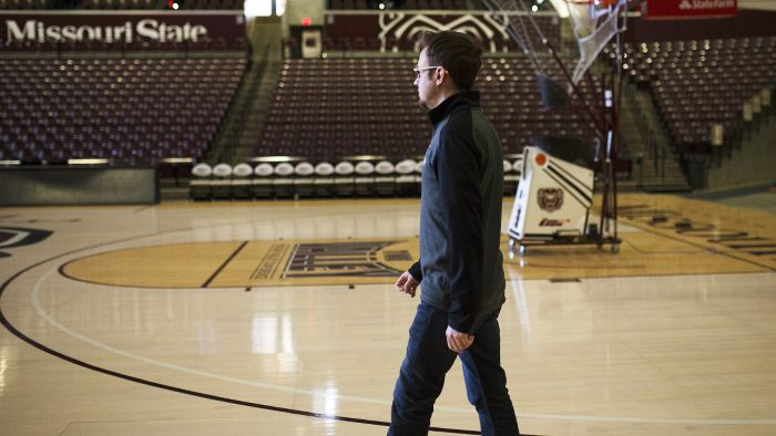 Kevin Agee on the basketball court at John Q. Hammons Arena