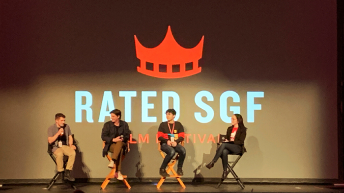 Three panelists and a moderator, seated on stage in front of the Rated SGF logo