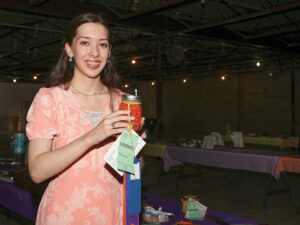 Photo of Eileen Shafer holding a canned item