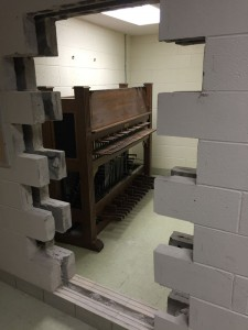 Workers had to open up walls to removing some of the practice pianos and organs out of Ellis Hall.