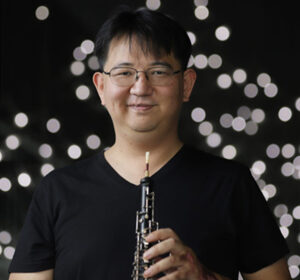 Photo of Cooper Wright with his oboe (Photo Credit: Jung Choi)