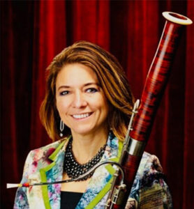 Photo of Lia Uribe with her bassoon (Photo Credit: Jung Choi)