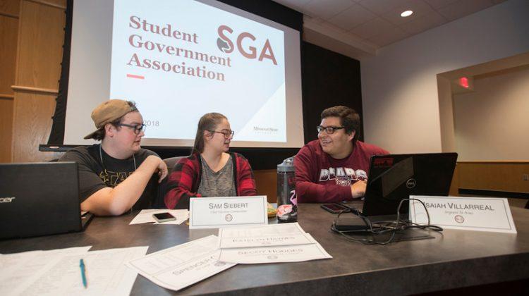 Isaiah Villarreal chats with students at a Missouri State SGA meeting