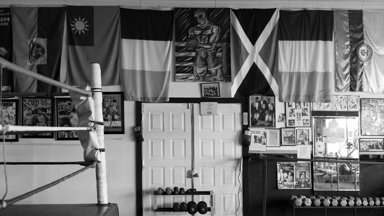 A boxing gym in black and white