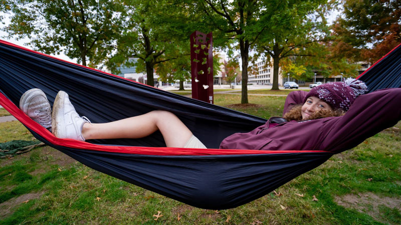 A student in a hammock.