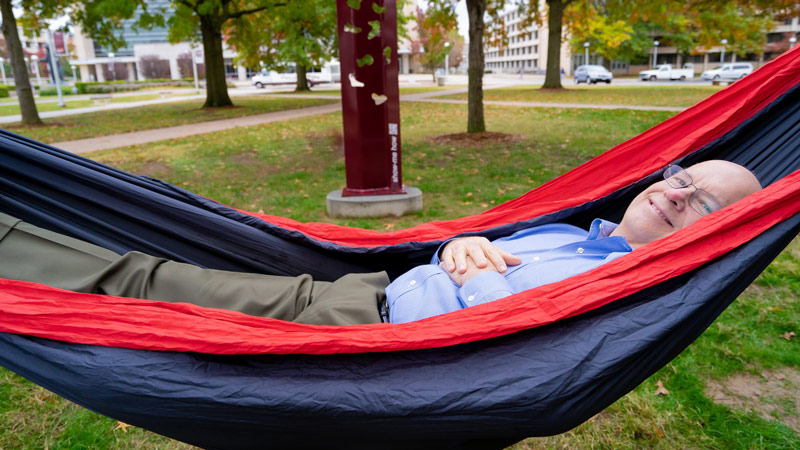 The president of Missouri State, Clif Smart, tries out the new hammock towers.