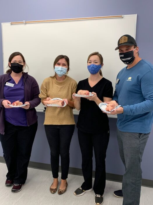 2nd-year and 3rd-year FNP students at suturing workshop