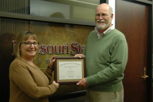 Marilyn B. Odneal being awarded by Gary Rader